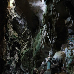The cave ceiling with a view of a Buddha statue scene
