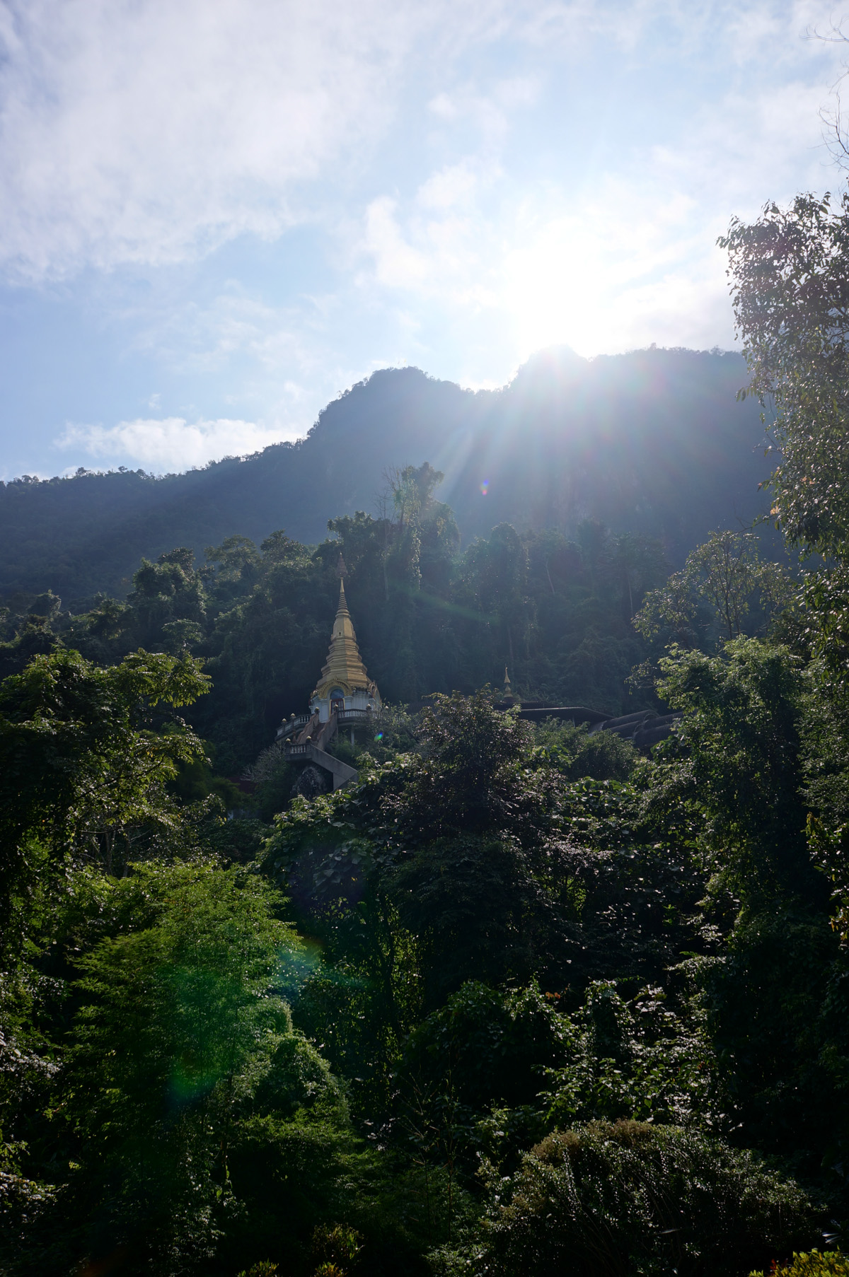 Another view of Wat Tham Pha Plong temple with more sun peeking over the mountain