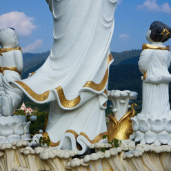 Statues overlooking the hills and valley of Thaton from the temple Wat Thaton