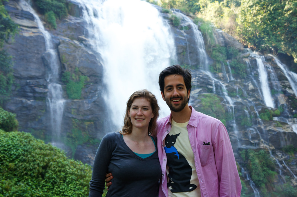 Us in front of a gorgeous, misty waterfall on the way back down from the peak